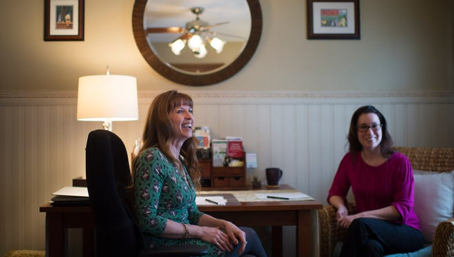 Kathy Dickson of Vital Body Wellness, left, sits down with her former client Nancy Daiutolo inside her home office in Newfield.