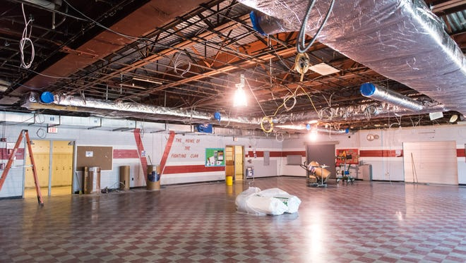 The cafeteria lays barren in the 53-year-old Vineland High School South on Wednesday, July 27 as workers install air conditioning into the school.
