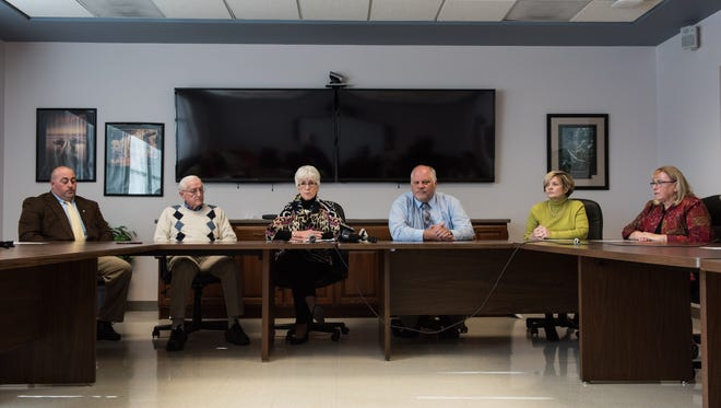 From left, Scott Collins, Charles Bireley, Susan Bunting, Mark Steele, Celeste Bunting, and Jan Steele speak to the media on Friday, Nov. 18, 2016.