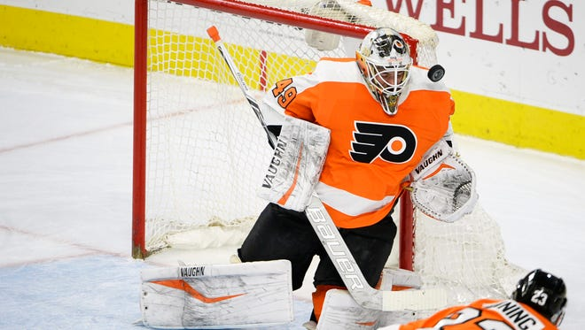 Alex Lyon agreed to a new two-year contract with the Flyers Saturday to avoid arbitration.