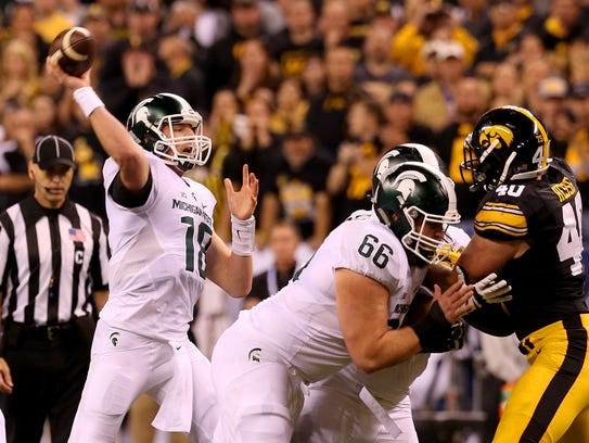 Michigan State quarterback Connor Cook (18) delivers