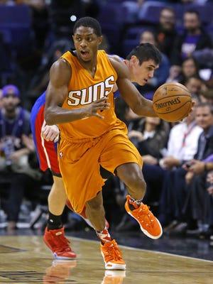 Phoenix Suns guard Brandon Knight (3) steals the ball from Detroit Pistons forward Ersan Ilyasova (23) in the first half of their NBA game Friday Nov. 6, 2015 in Phoenix, Ariz.