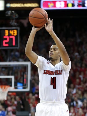 U of L's Quentin Snider (4) hit a jump shot against UK during their game at the KFC Yum! Center.