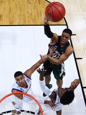 Michigan State's Miles Bridges shoots against Kansas' Landen Lucas, left, and Josh Jackson during MSU's 90-70 loss in the second round of the NCAA tournament at BOK Center on March 19, 2017 in Tulsa, Okla.