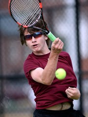Henderson County's Deegan Lawrence returns the ball as he volleys with Hopkins County Central's Chase French during the last year's Second Region Tennis Tournament at the Henderson Water Street Courts, May 11, 2016.