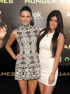 Aww, baby Kylie! The youngest member of the Kardashian-Jenner clan, right, wore a simple white dress while attending the 'The Hunger Games' premiere on March 12, 2012, in Los Angeles.