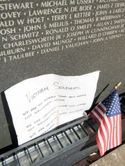 A note and an American flag are among the items left along Wall South by visitors at Veterans Memorial Park in Pensacola on Tuesday, October 24, 2017.