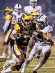 Golden West's Gonzalo Rodriguez runs for a touchdown