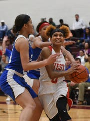 Natchitoches Central guard Jolie Williams drives to