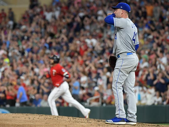 Kansas City Royals starting pitcher Danny Duffy reacts after allowing a home run by Minnesota Twins' Nelson Cruz, rear, during the second inning of a baseball game Saturday, Aug. 3, 2019, in Minneapolis. (Aaron Lavinsky/Star Tribune via AP)