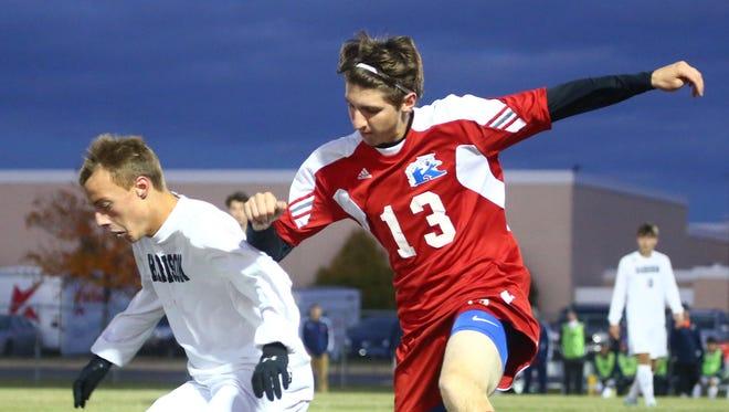 Harrison's Daniel Madren and Kokomo's Robert Martin compete for the ball.