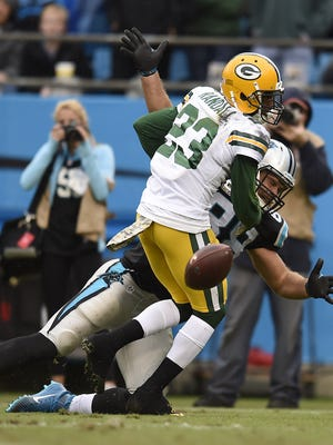 Green Bay Packers cornerback Damarious Randall (23) breaks up a pass intended for Carolina Panthers tight end Greg Olson earlier this season. He was called for pass interference on the play.
