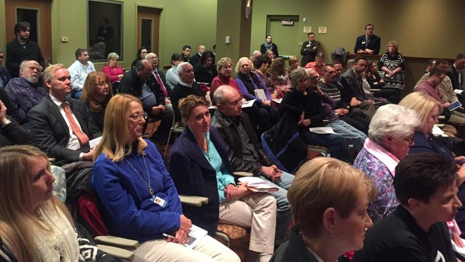 """A crowd, including a contingent of teachers in the second row, filled all chairs inside Campbell County Fiscal Court chambers in Newport for the Northern Kentucky Forum's """"A Look Ahead at the 2016 General Assembly."""""""