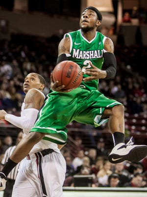 Marshall Thundering guard Chris Thomas (2) shoots the ball past South Carolina Gamecocks guard Tyrone Johnson (4) in the second half at The Colonial Life Arena.