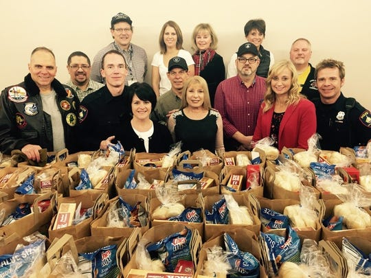 Members of the Fond du Lac Police Department and police chaplains pose in front of gift packages to be given to the less fortunate.