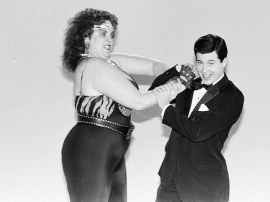 Matilda the Hun and David McLane pose for a Gorgeous Ladies of Wrestling promotional image.