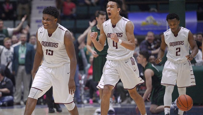 Aquinas' Jamir Jones, left, Jason Hawkes and Earnest Edwards celebrate their overtime win following a Class AA semifinal at the 2016 NYSPHSAA Boys Basketball Championships held at the Glens Falls Civic Center in Glens Falls on March 12, 2016.