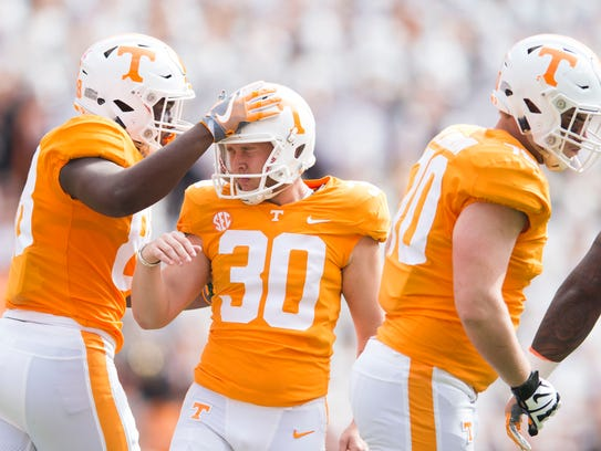 Tennessee place kicker Brent Cimaglia (30) is congratulated