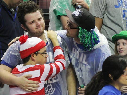 FGCU's fans Chance Fernandez, bottom, Jacob Barrett