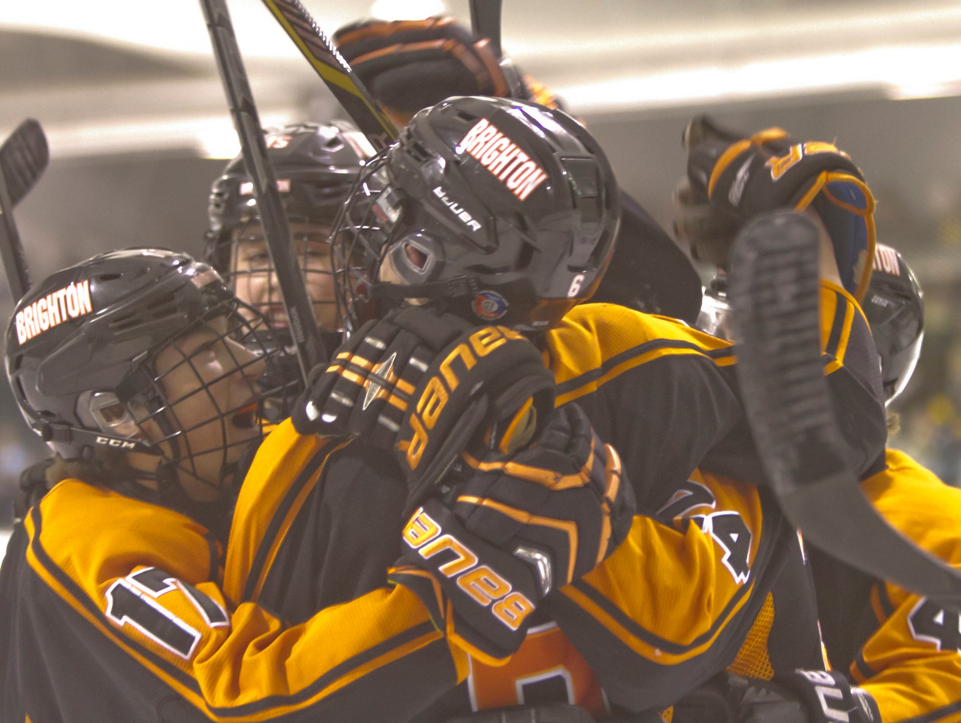 Brighton celebrates Colin Bilek's goal in the first period of Wednesday's 4-3 overtime loss to Howell at Grand Oaks Ice Arena.