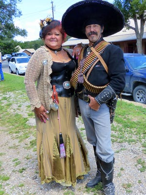 Decked out in proper period garb, a couple set the mood for Old Lincoln Days Friday through Sunday in the Lincoln Historic District.