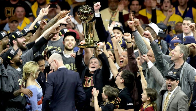 Cleveland Cavaliers owner Dan Gilbert, holds the Larry O'Brien Championship Trophy after the Cavaliers defeated the Golden State Warriors 93-89 in Game 7 of the 2016 NBA Finals at ORACLE Arena on June 19, 2016 in Oakland, California.
