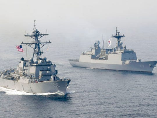 In this Tuesday, April 25, 2017 photo released by the U.S. Navy, the Arleigh Burke-class guided-missile destroyer USS Wayne E. Meyer, left, is underway alongside the Republic of Korea multirole guided-missile destroyer Wang Geon during a bilateral exercise. Wayne E. Meyer was on a scheduled western Pacific deployment with aircraft carrier USS Carl Vinson.