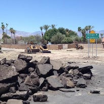 A roundabout is being built at Avenue of the States and California and Michigan drives in Palm Desert. Work was not affected by recent storm damage.