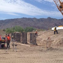 Construction crews work on the Tex Wash Bridge repair project in Desert Center. The area had an average high temperature of 104 degrees.