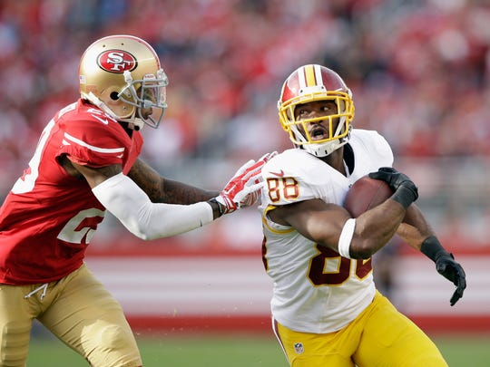 Pierre Garcon #88 of the Washington Redskins avoids a tackle by Chris Culliver #29 of the San Francisco 49ers in the first half at Levi's Stadium on November 23, 2014 in Santa Clara, California.