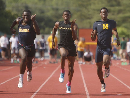The finish of the Group III boys 100 dash: Colonia's
