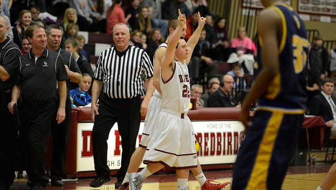 De Pere High School boy's basketball team manager Nate Wagner, who had down syndrome, enters his first game as a player against Sheboygan North during Friday night's game at De Pere High School. Evan Siegle/Press-Gazette Media