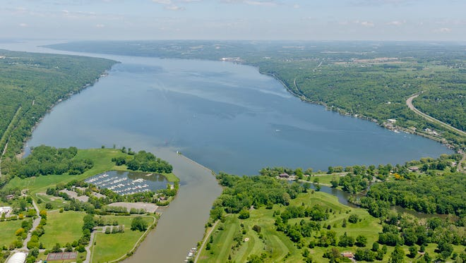 Cayuga Lake with Cass Park, left,  Newman Golf Course, lower right, in May of 2014. Phosphorus is a concern in Cayuga Lake because it promotes algal growth, and algae has impaired southern Cayuga Lake for swimming. The impairment led Cayuga's Southern end to become listed in 2002 for violating the U.S. Clean Water Act.