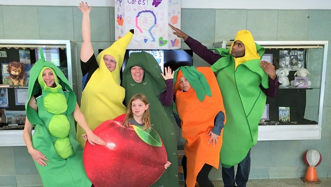 PTO parents, from left, Laurie Crawford, president; Jennifer Bower; Lynn Lowe; Jess Kishbaugh; and Matt Davis; and student Kate Crawford dressed as animated fruits and vegetables to kick off Cornwall Elementary School's celebration of 'Go For the Greens' week. Throughout March, students in the Cornwall-Lebanon School District have been celebrating 'Go For The Greens,' an event that promotes green vegetables, healthy eating, good food choices and staying healthy. At Cornwall Elementary School last week, the PTO sponsored fun activities each day, including a lunchbox competition, chef demonstration and visit to school garden.