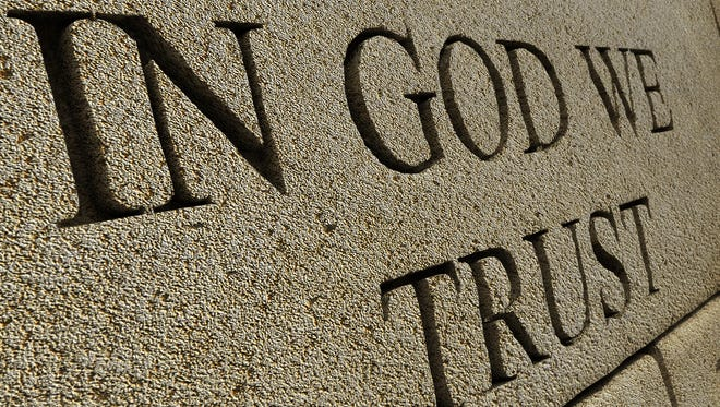 "The U.S. Congress adopted ""In God We Trust"" as the national motto in 1956. A bill passed by the Tennessee legislature this year says the motto must be prominently displayed in the state's public schools."