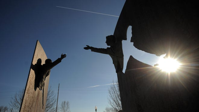 The two-piece art display of Dr. Martin Luther King Jr. and Robert F. Kennedy at the Dr. Martin Luther King Jr. Park at 1702 Broadway St.