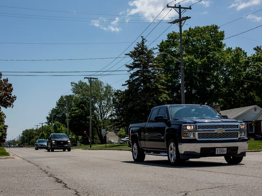Vehicles travel along Huron Boulevard Friday, June 2, 2017 in Marysville. The city is planning a three-phase rebuild of the roadway between M-29 and Gratiot Boulevard, reducing it from a four-lane road to one lane in each direction with a center left turn lane.