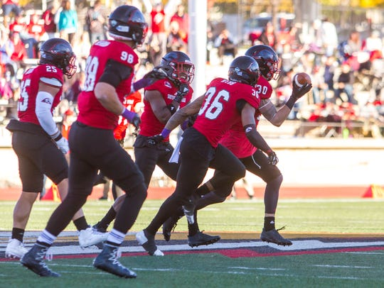 Southern Utah's defense celebrates an interception