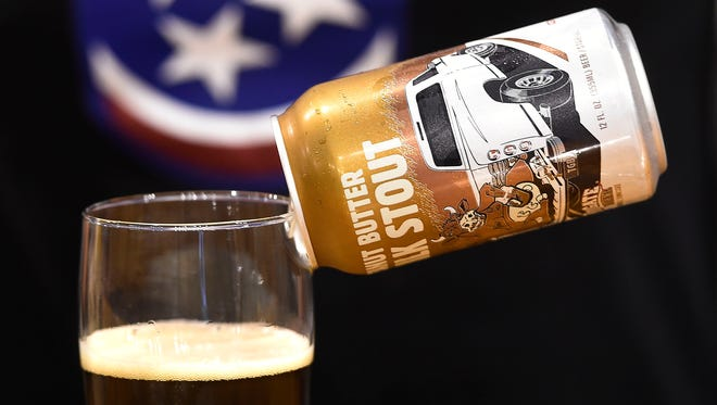 Wesley Keegan, owner of Tailgate Beer in West Nashville prefers to have his beer in cans instead of bottles. Tuesday April 26, 2016, in Nashville, TN
