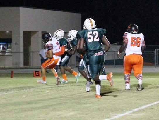 Dunbar's Bakari Jackson makes a tackle against Lely
