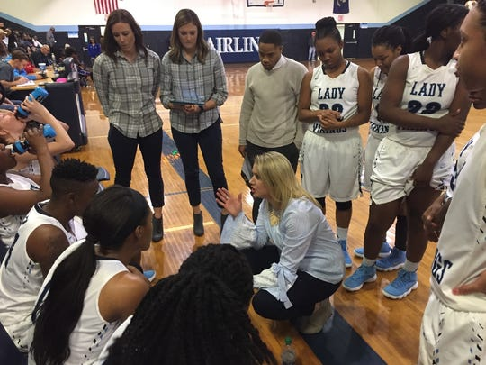 Airline coach Lyndzee McConathy gives her team instructions during Friday's game with Evangel.