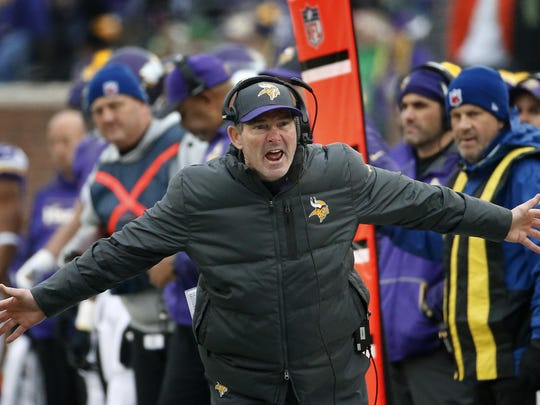 """Minnesota Vikings coach Mike Zimmer argues a call during the team's Dec. 6, 2015, game against the Seattle Seahawks in Minneapolis. Zimmer, speaking of quarterback Teddy Bridgewater, said, """"He wins games, and to me that's the most important thing. There's a lot more to playing quarterback than just throwing the ball through the wall."""""""