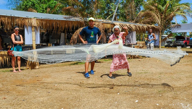 Antonia Tolentino Degracia Castro demonstrates how to throw a talaya, or cast throw net, during the Festival of Pacific Arts at the Paseo in Hagatna on Thursday, June 2.