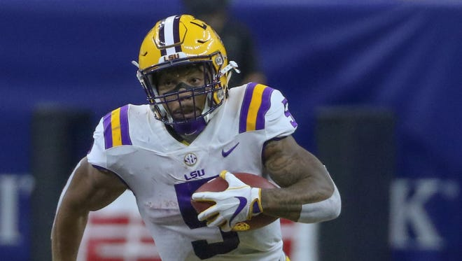 LSU Tigers running back Derrius Guice (5) runs against the Brigham Young Cougars during the first quarter of the AdvoCare Texas Kickoff game at the Mercedes-Benz Superdome.