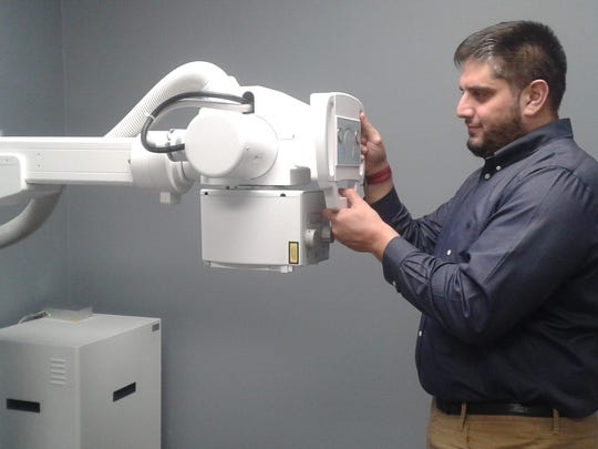 Ghaz Shukairy, urgent care manager, checks out the state-of-the-art x-ray equipment.