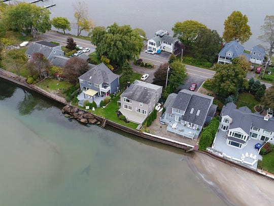 These homes on Lake Road in Webster have only a small stretch of land it sits on between Irondequoit Bay and Lake Ontario.