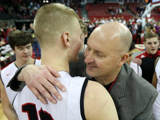 News he would miss the rest of the high school basketball season after undergoing ankle surgery Dec. 11 has been tough on SPASH standout Joey Hauser and his parents Dave, right, and Stephanie Hauser.