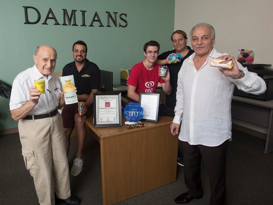 Damian's owner Tony Jacobs, right, poses with four
