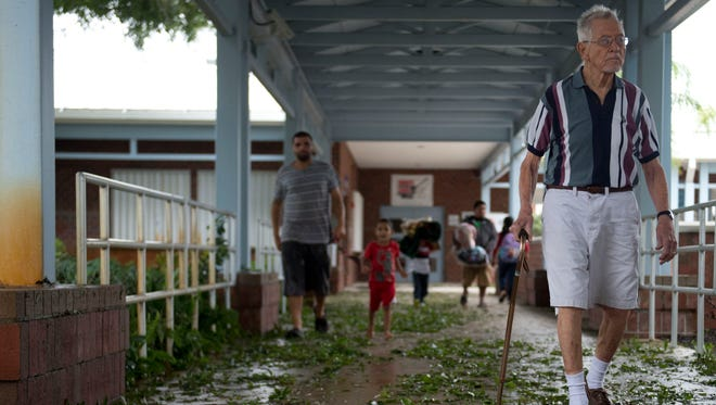 """Howard Bosworth, of Stuart, leaves the American Red Cross shelter at Hidden Oaks Middle School in Palm City with his wife Leone (not pictured) Friday following Hurricane Matthew. They have stayed in shelters before during hurricanes and decided to come in for this one because they """"weren't quite sure"""" about their home, according to Howard."""