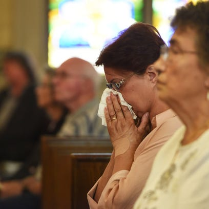 Parishioners gather for the final Mass at St. Joseph's Church today.